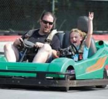 Father and son go-karting at Grand Prix Amusements Photo