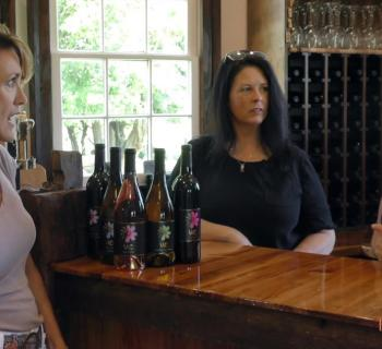 Three ladies enjoying a glass of wine at the Windmill Creek Vineyard and Winery Photo