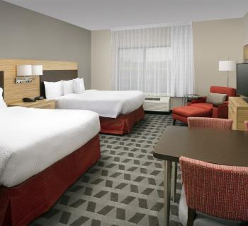 Guest room at TownePlace Suites Photo
