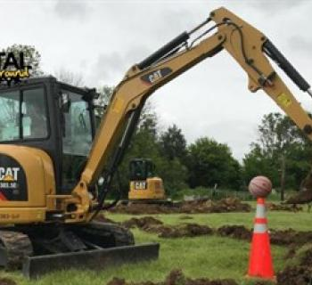 Track excavator with basketball Photo