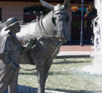Statue of boy and donkey Photo