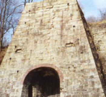 Entrance to stone blast furnace Photo