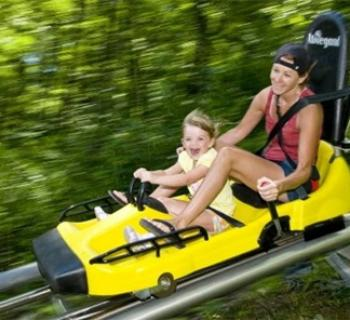 Woman and girl on Mountain Coaster at Wisp Photo