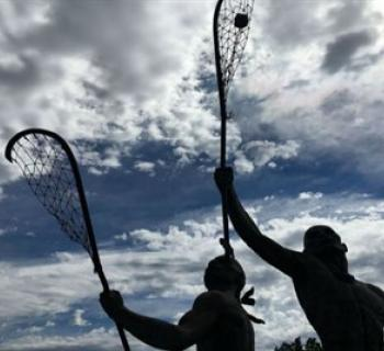 Statue of Native Americans playing LAX Photo