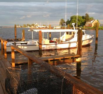 A fishing boat docked at a pier in Tilghman Island Photo