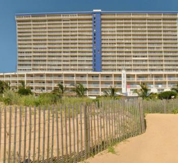 Beach view of Carousel Oceanfront Hotel and Condominiums Photo