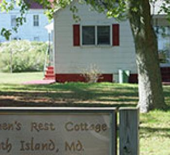Fishermen's Rest Cottage with Sign Photo