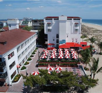 Aerial View of Coconut's Bar & Grill  beach & oceanfront patio. Photo