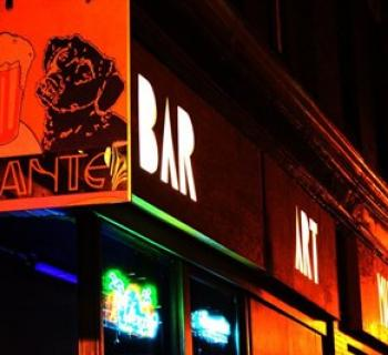 Dant's Bar, Art, Music sign lights up the night. Photo