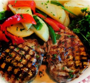 Grilled Pork Chops, mixed vegetables and broccoli Photo