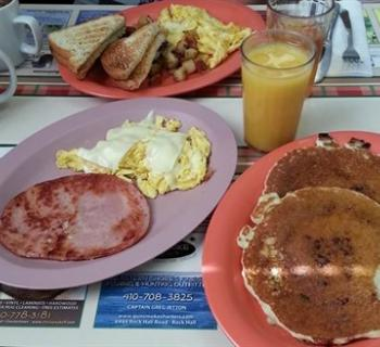 Pancakes, eggs, ham and juice Photo