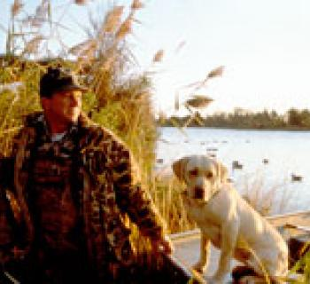 Hunter with yellow lab Photo