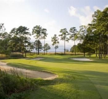 Picture of a fairway and sand traps at the Swan Point Yacht & Country Club Photo