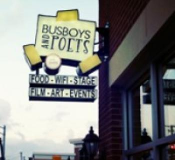 Busboys and Poets sign hangs over the Hyattsville Arts District. Photo
