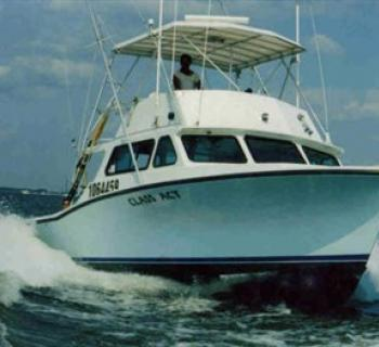 Class Act Sportfishing Charter Boat on the water. Photo