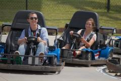 Boy and girl riding in go karts