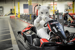 Bunny mascot riding in a go kart