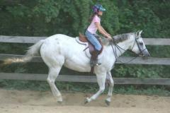 A young rider at En-Tice-Ment-Stables