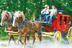 People riding stage coach at Frontier Town