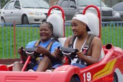 Two people riding in a GoKart