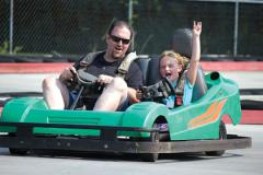 Father and daughter riding in a GoKart