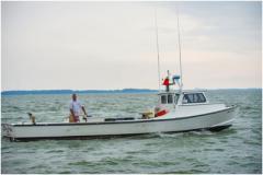 captain and his fishing/crabbing boat