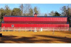 The long red barn at Southern Grace Farm