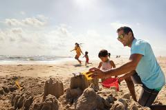 Family building sandcastle