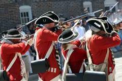 Colonial Re-enactors firing their rifles