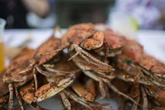 Get the crabs piled high on your plate, and pass the Old Bay!
