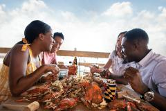eating crabs by the water