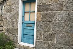A Blue Door and Stone Wall in Ellicott City