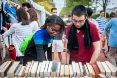 People looking at books at the Baltimore Book Festival