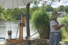 painter by lake