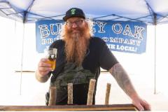 Guy drinking beer at beer festival