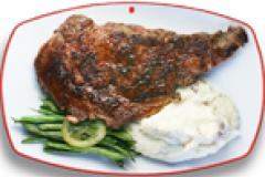 Ribeye steak with mashed potatoes and green beans