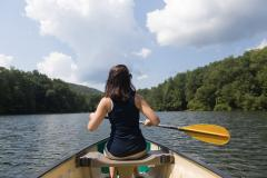 A woman rowing in a lovely lake