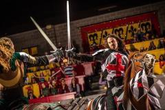 Two knights dueling with sords on horse back at Medieval Times