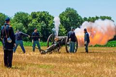 Union soldier reenactors firing a canon