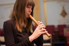Woman playing recorder