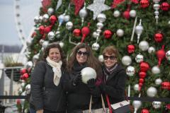 women in front of christmas tree