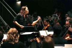 Woman conducting orchestra