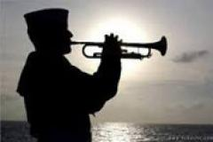 Navy Sailor playing taps