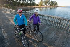 Two Bicyclists Stop to Take in the Water View