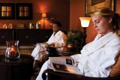 Two women wear white robes at Turf Valley Spa