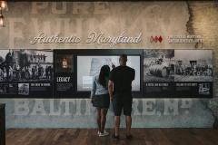 A couple viewing exhibits at the distillery