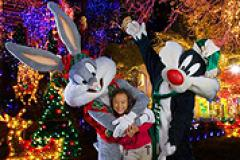 Bugs Bunney and Sylvester the cat with a little girl at Six Flags America's Holiday In The Park