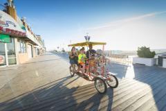 family on pedal surrey on Ocean City Boardwalk