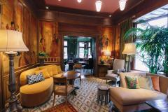 The Ivy Hotel's lush interior offers multiple places to relax in luxury