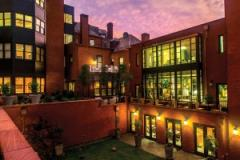 "A view of the Courtyard at Dusk of  ""The Ivy"" Hotel in Mount Vernon"